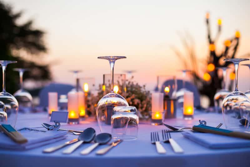 Romantic set up dinner set on the beach.(Selactive focus)
